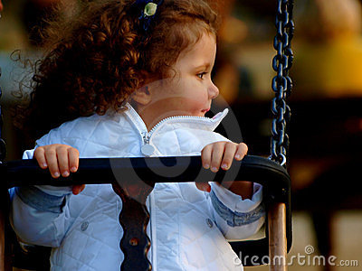 Little baby girl on see saw