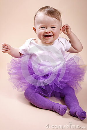 Little baby girl sitting in tutu skirt