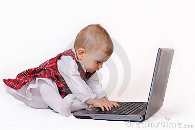 Little baby and laptop