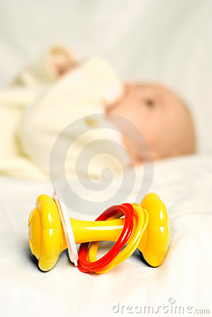 Free Little Baby Lies On The Bed With A Toy Royalty Free Stock Photo - 7886845
