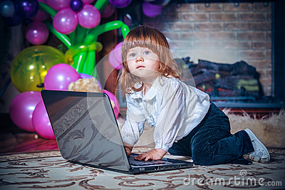 Little Baby Playing With Laptop Stock Photos - Image: 28221843
