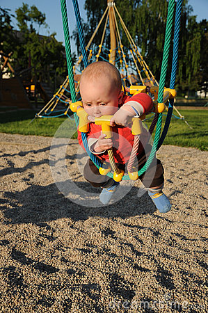 Little baby in rope swing