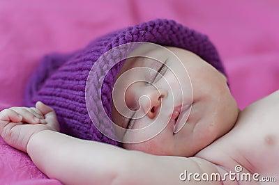 Little baby sleeps in hat