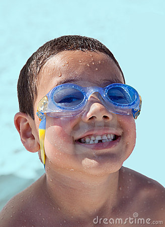 Little Beach Boy with Goggles Laughing Closeup