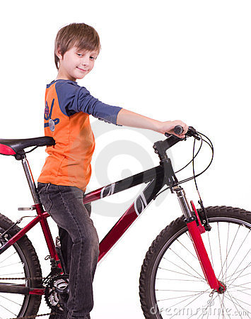 Little beautiful boy with bycicle