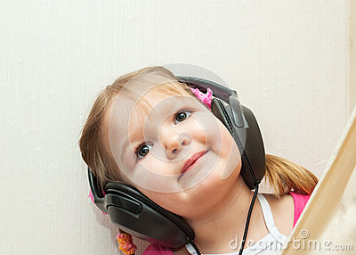 Little beautiful girl in headphones