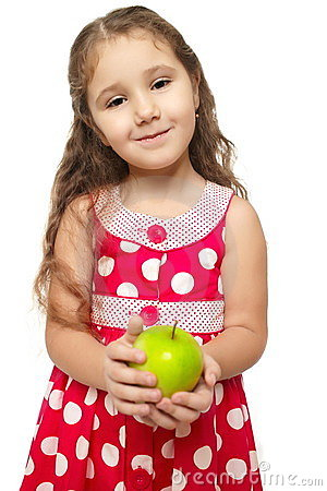 Little beautiful girl in pink clothes green apple