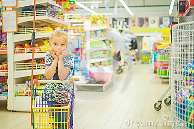 Little beautiful girl in supermarket