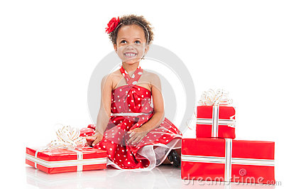 Little beautiful mulatto girl with gifts