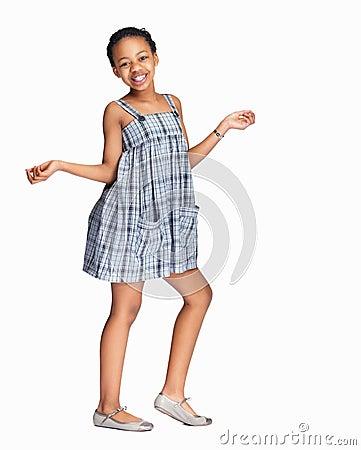 Little black girl dancing against white