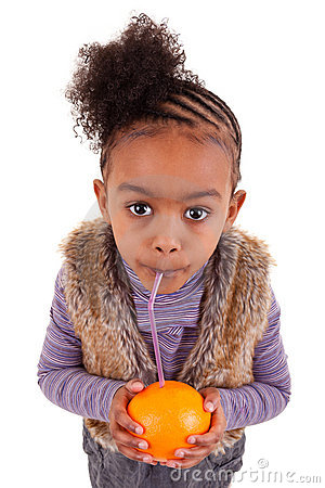 Little black girl drinking orange juice