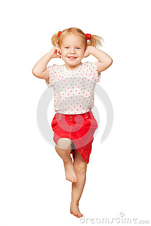 Little blond girl smiling and dancing.