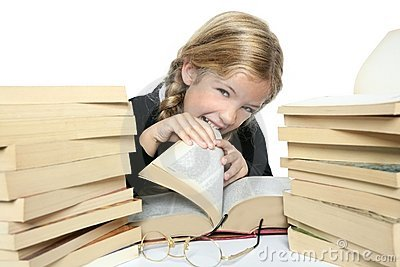 Little blond student girl eating her books
