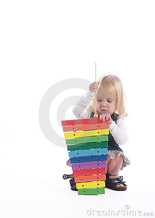 Free Little Blonde Girl Playing Musician Stock Photos - 20243293