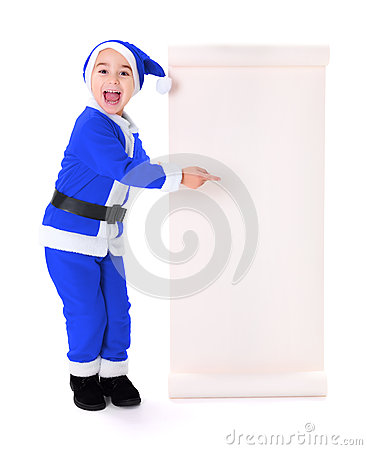 Little blue Santa Claus boy pointing at big wish list