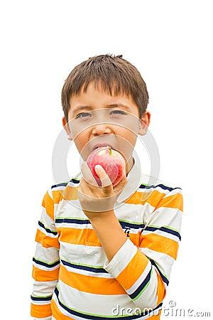 A little boy with an apple