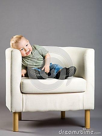 Little boy in armchair