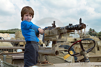 Little boy in a army jeep
