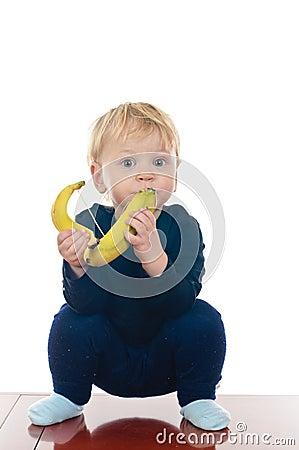 Little boy with banana