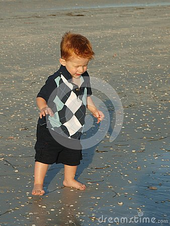 Little boy on the beach alone