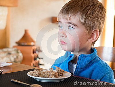 Little boy behind table