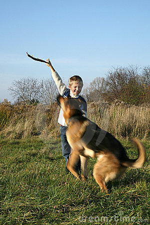 Little boy and big dog (German Shepherd ).