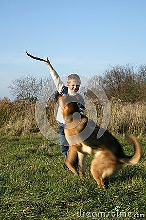 Little boy and big dog (German Shepherd ).