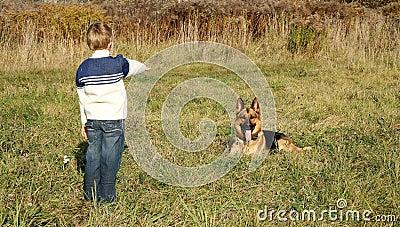Little boy and big dog (German Shepherd )