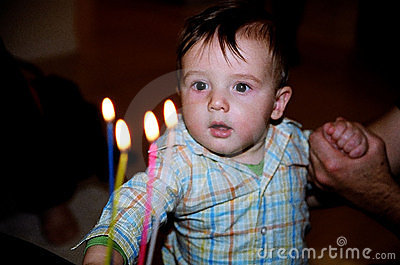 little boy with birthday cake candles