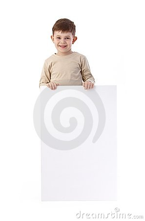 Little boy with blank sheet smiling