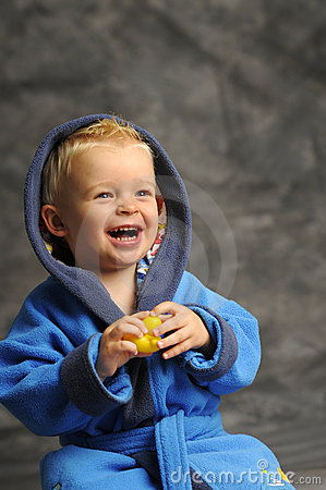 Little boy in blue bath robe