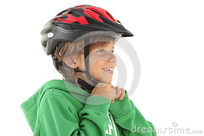 Little boy buckle up his bicyle helmet