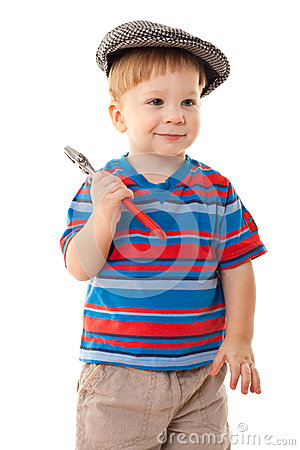 Little boy in cap with wrench