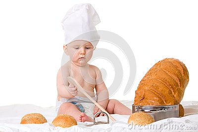 Little boy chef with spoon