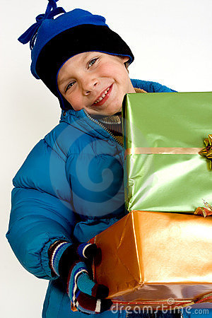 Little boy with christmas gifts