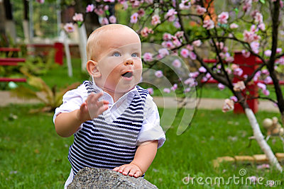 Little boy clapping in the park