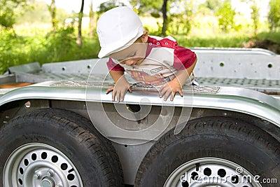 Little Boy Climbing Trailer