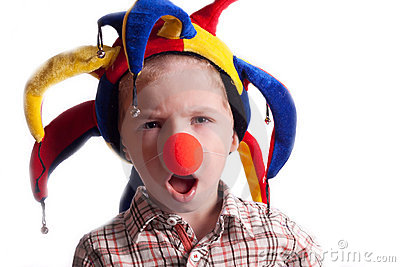 A little boy with a clown nose clown in a hat