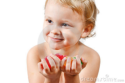 Little boy with colored jelly candies