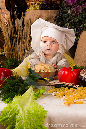 Little boy in the cook costume