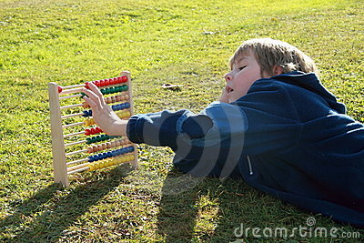 Little boy counting on an abacus