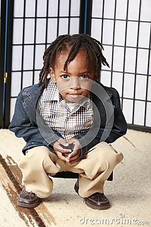Little boy crouching