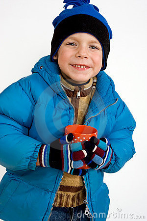 Little boy with cup of hot tea