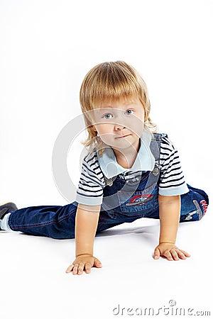 The little boy in dark blue overalls