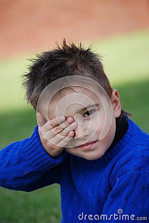 Little boy in a dark blue sweater
