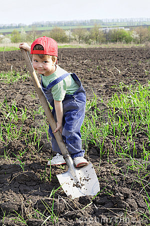 Little boy dig with big shovel