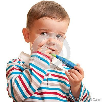Little boy discovering teeth brushing