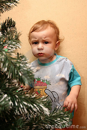 Little boy with distrustful look