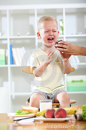 Free Little Boy Does Not Want To Eat. Stock Photos - 56390443