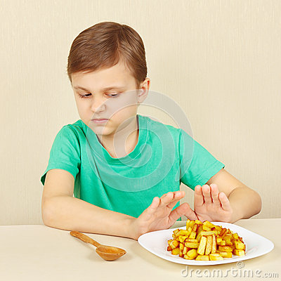 Free Little Boy Does Not Want To Eat Fried Potatoes Royalty Free Stock Images - 68521699